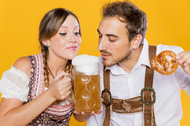 Young man and woman ready to taste beer Free Photo