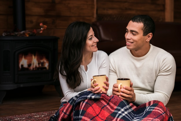 Young man and woman smiling at each other Free Photo