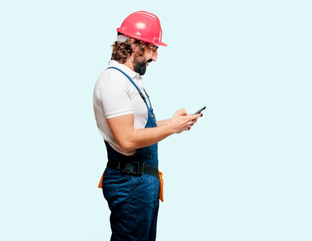 Young man worker with a mobile phone Premium Photo