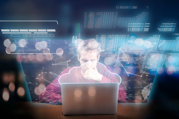 Young man working on laptop futuristic icons and interface pop out from screens device Premium Photo