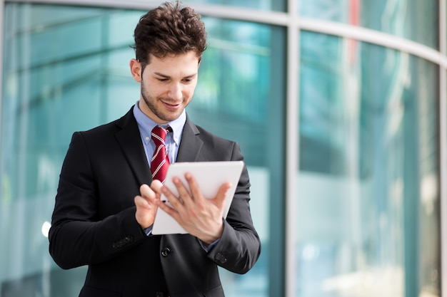 Young manager using a digital tablet outdoor Premium Photo