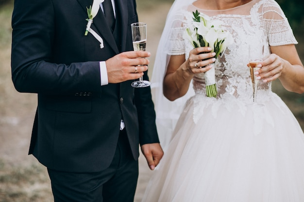 Young married couple drinking champaigne together Free Photo