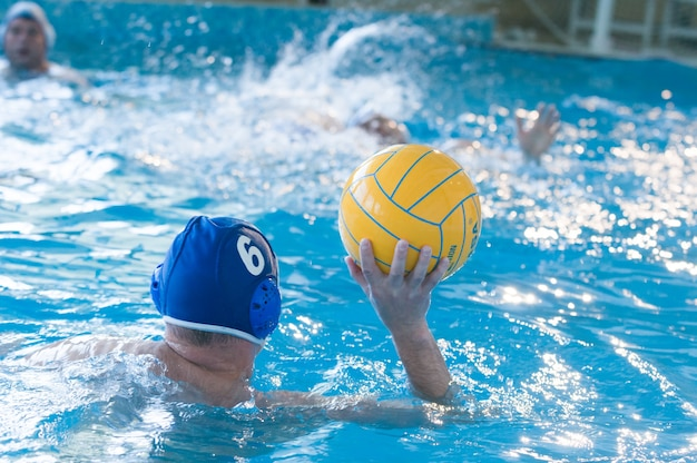 Young men playing waterpolo Premium Photo
