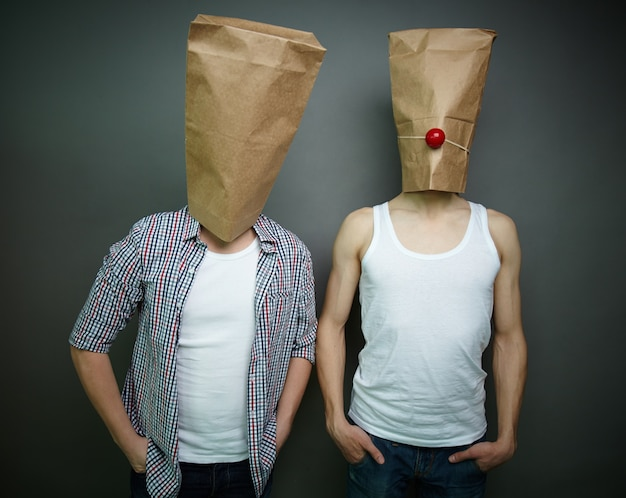 Young men with paper bags over their heads Free Photo