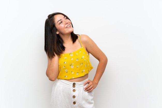 Young mexican woman over isolated wall thinking an idea Premium Photo