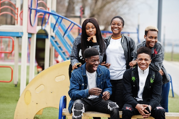 Young millennials african friends walking in city. happy black people having fun together. generation z friendship concept. Premium Photo