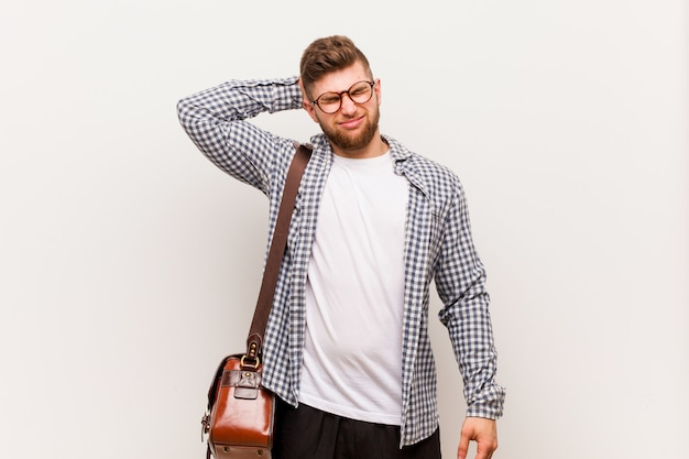 Young modern business man suffering neck pain due to sedentary lifestyle. Premium Photo