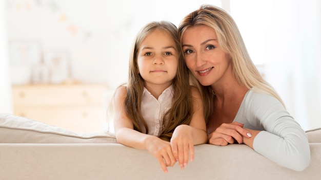 Young mother and daughter posing together Free Photo