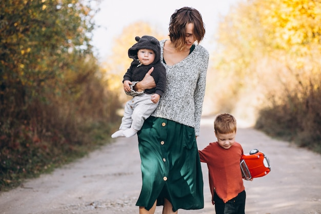 Young mother with two sons walking in park Free Photo