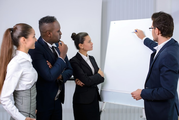 Young multiethnic business team planning a new strategy. Premium Photo