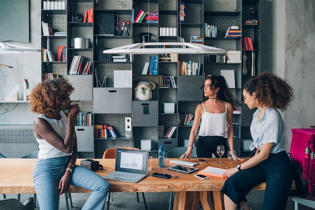 Young multiracial businesswomen having informal meeting in modern co-working office Premium Photo