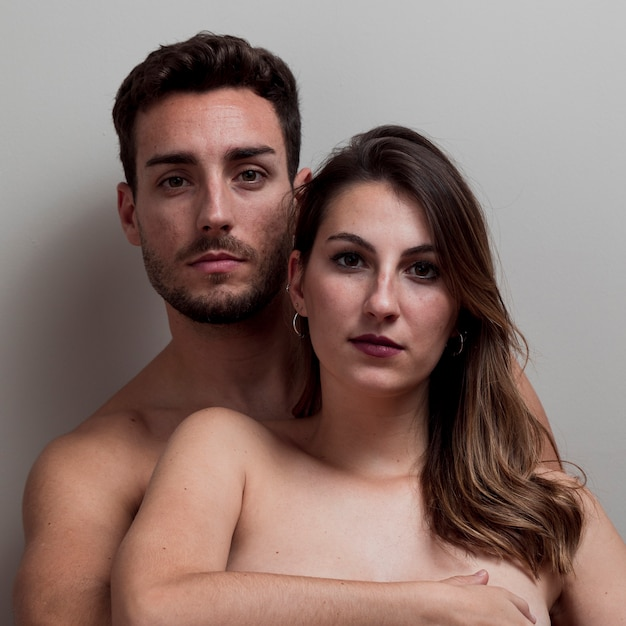 Young naked couple embracing Free Photo