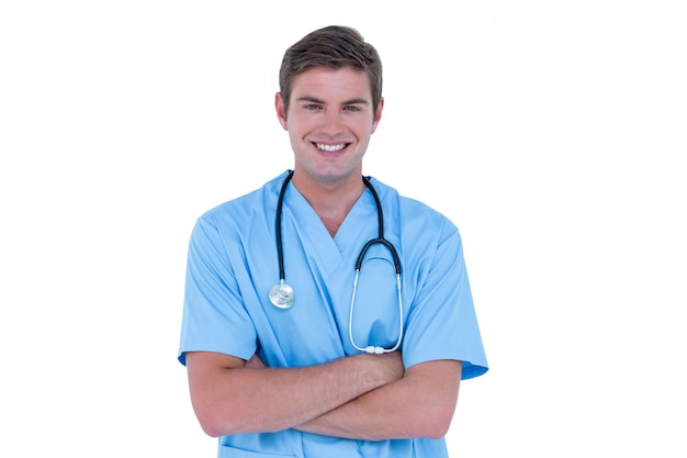 Young nurse in blue tunic with arms crossed Premium Photo