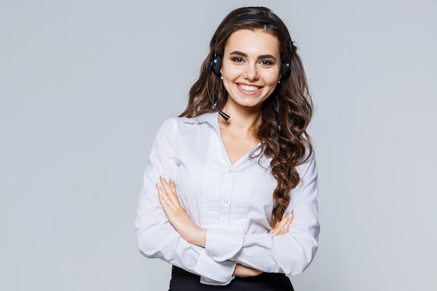 Young operator woman agent with headsets standing near gray. call center service. Premium Photo