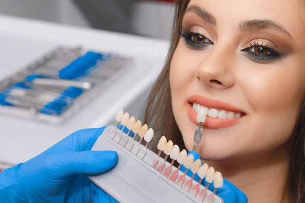 Young patient selects tooth color Premium Photo