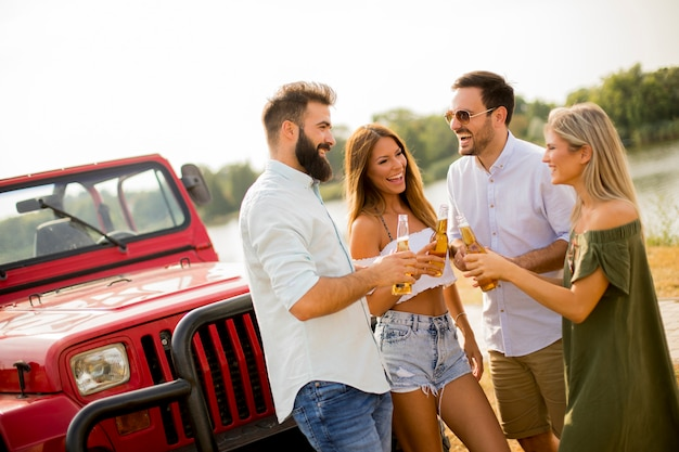 Young people drinking and having fun by car Premium Photo