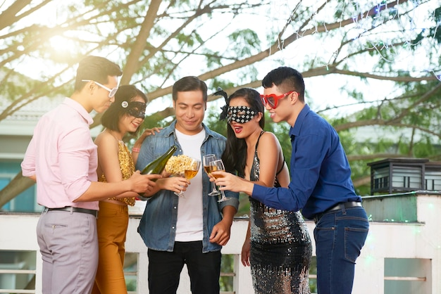 Young people enjoying in a masquerade party Free Photo