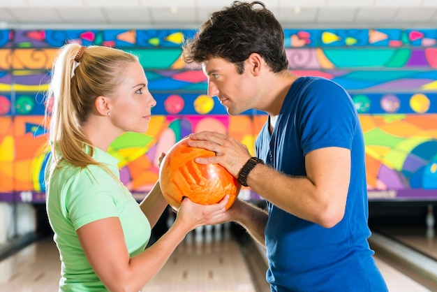 Young people playing bowling and having fun Premium Photo