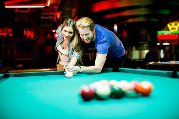 https://image.freepik.com/free-photo/young-people-playing-pool_52137-13419.jpg
