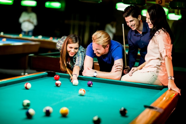 Young people playing pool Premium Photo