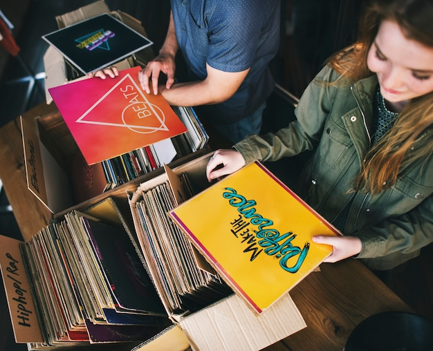 Young people in a record shop Premium Photo