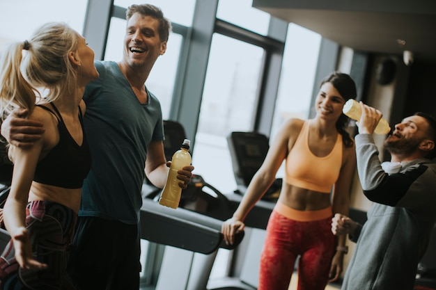 Young people resting and enjoying conversation after finished workout Premium Photo