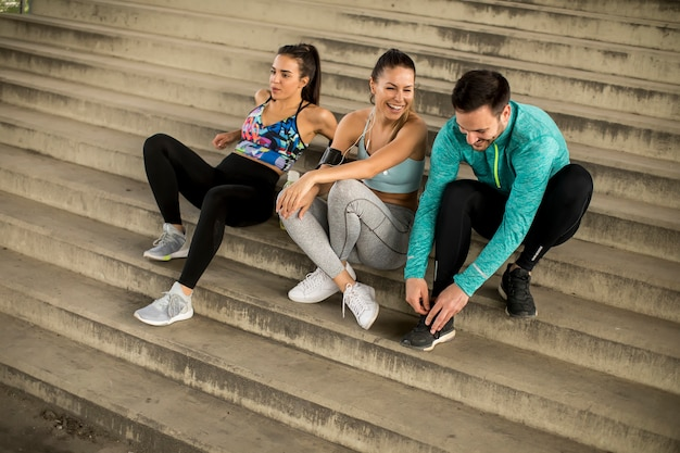 Young people  resting on stairs after training Premium Photo