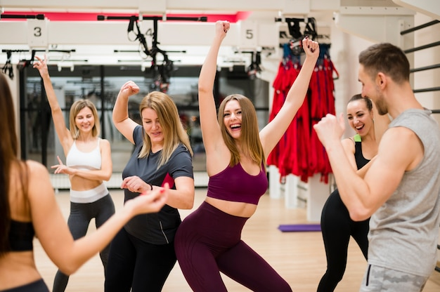 Young people training together at the gym Free Photo