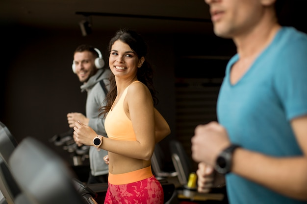Young people using threadmill in modern gym Premium Photo