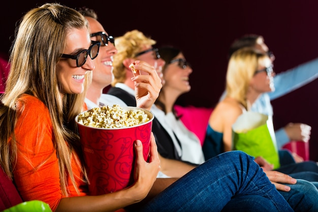 Young people watching 3d movie at movie theater Premium Photo