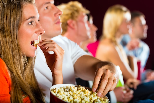 Young people watching movie at movie theater Premium Photo