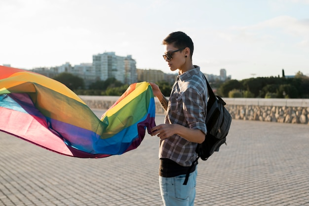 Young person with flying lgbt flag Free Photo