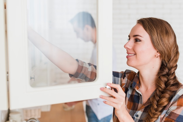 Young positive couple in kitchen at home Free Photo