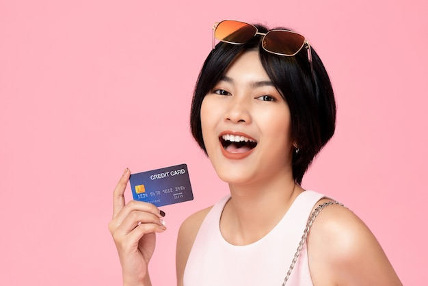 Young pretty asian woman with credit card in hand Premium Photo
