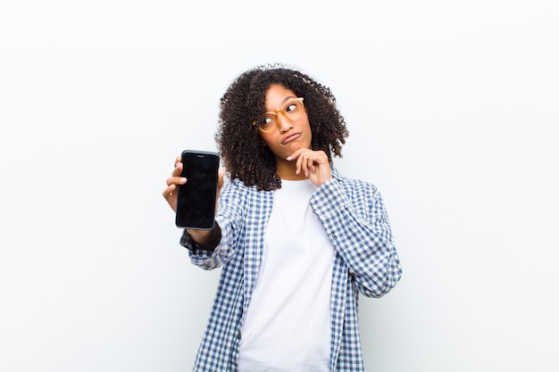 Young pretty black woman with a smart phone Premium Photo