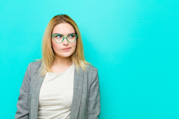 Young pretty blonde woman looking puzzled and confused Premium Photo