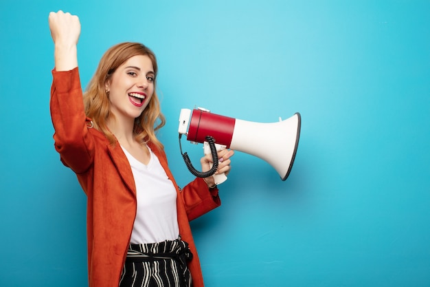 Young pretty blonde woman with a megaphone Premium Photo