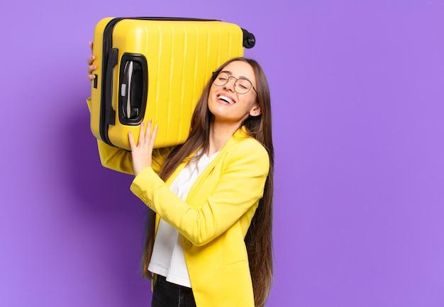 가방으로 젊은 예쁜 사업가 프리미엄 사진