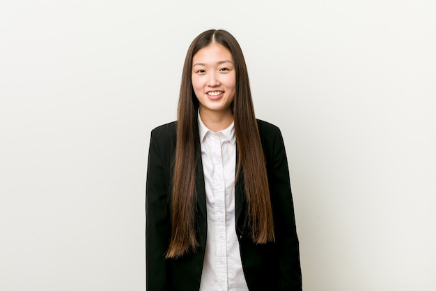 Young pretty chinese business woman happy, smiling and cheerful. Premium Photo