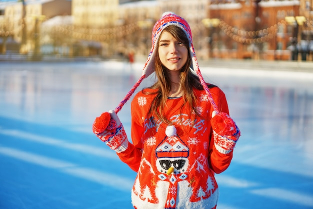 Young pretty woman ice skating winter people Premium Photo