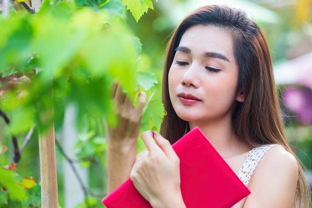 Young Pretty Woman Looking Grape Tree With Happiness Photo