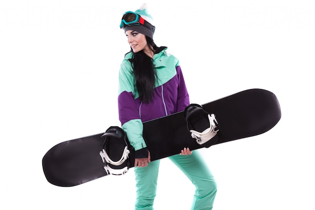 Young pretty woman in purple ski suit hold snowboard Premium Photo
