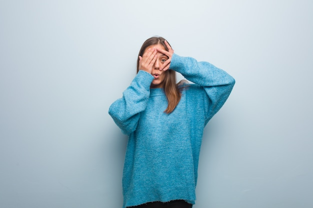 Young pretty woman wearing a blue sweater feels worried and scared Premium Photo