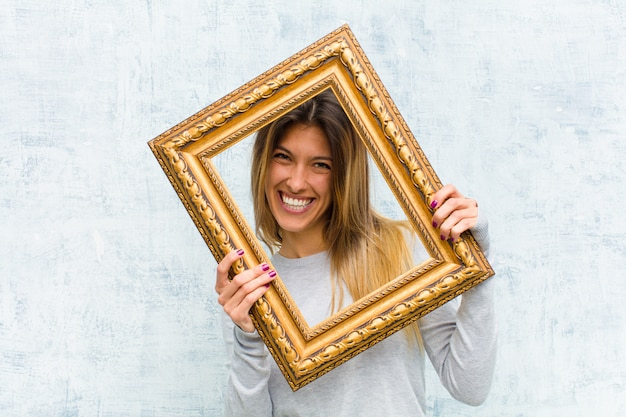 Young pretty woman with a baroque frame Premium Photo