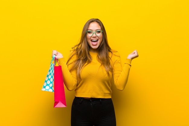 Young pretty woman with shopping bags Premium Photo