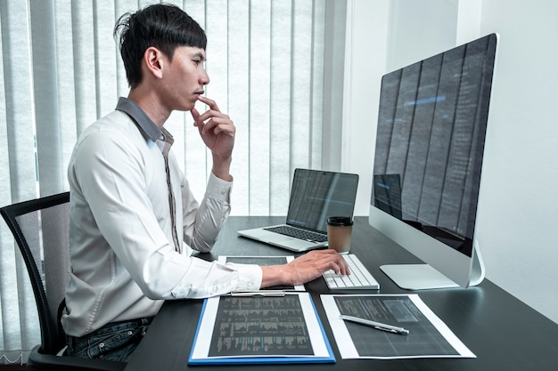 Young programmer working in software javascript computer in it office Premium Photo