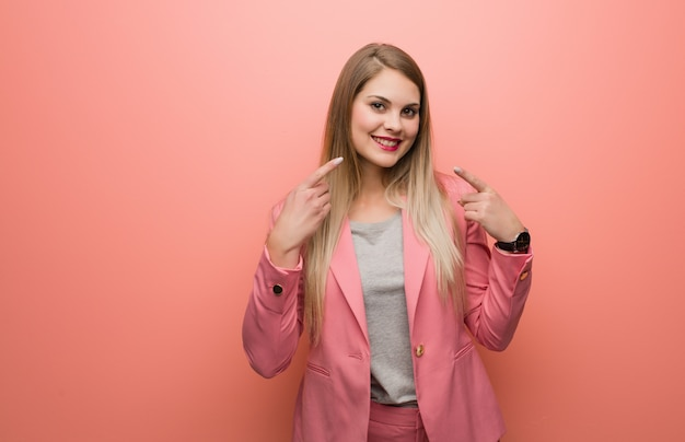 Young russian woman wearing pajama smiles, pointing mouth Premium Photo