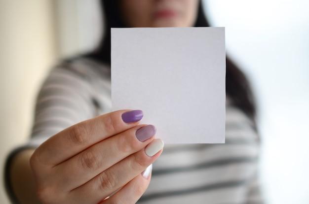 Young sad girl shows a white sticker Premium Photo