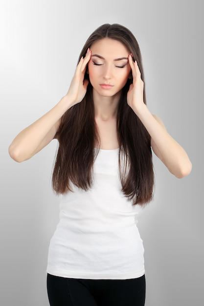 Young sad woman touch forehead and feel strong head ache Premium Photo