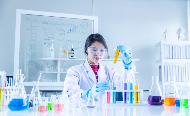 Young scientist looking through a tube in a laboratory Premium Photo
